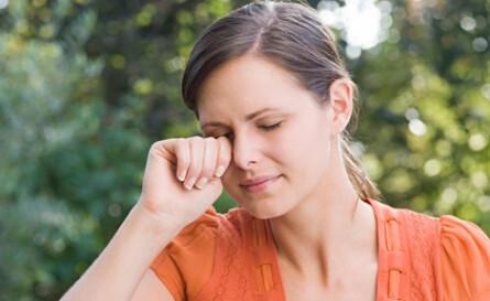woman suffering from dry eye symptoms